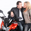 Stockfoto: Biker couple gazing into each other's eyes.