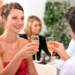 Couple with champagne glasses in restaurant — Stock Photo