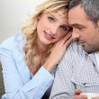 Close couple sitting on a sofa - Stock Photo