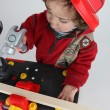 Small boy dressed as builder - Stock Photo