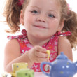 Young girl have a tea party — Stock Photo #8111599