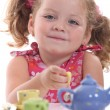 Young girl have a tea party - Stock Photo