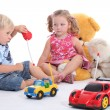 Children playing with toys — Stock Photo #8111607