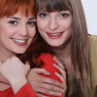 Two female friends hugging — Stock Photo