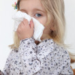 Little girl blowing her nose — Stock Photo #8111660