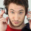 Man with headphones and cellphone — Stock Photo #8111690