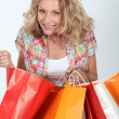 Woman looking in shopping bags — Stock Photo #8111845