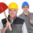Experienced tradesman standing in front of his apprentice — Stockfoto