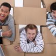Three men moving house — Stock Photo