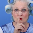 Old woman requesting to be quiet — Stock Photo
