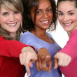 Stock Photo: Three friends pointing at camera.