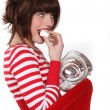 Girl eating marshmallows — Stock Photo
