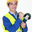 Tradesman holding an angle grinder — Stock Photo #8112256