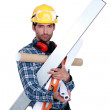 A handyman with his arms full. — Stock Photo #8112288