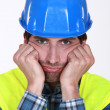 A grumpy and frustrated tradesman — Stockfoto