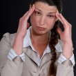 A businesswoman with a headache. — Stock Photo