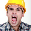 Craftsman having fit of anger — Stock Photo