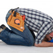 Construction worker curled up on the floor — Stock Photo