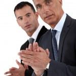 Businessmen applauding — Stock Photo
