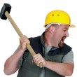 Angry craftsman holding a hammer — Stock Photo