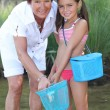 Stock Photo: Grandmother and granddaughter at riverside