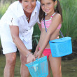Grandmother and granddaughter at the riverside — Stock Photo #8114733