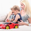 Mother and son playing with an toy car — Stock Photo
