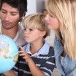 Family, reading, globe — Stock Photo
