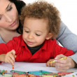 Mother sat with boy drawing — Stock Photo #8115121