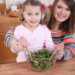Stock Photo: Mom and daughter cooking