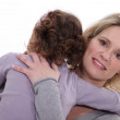 Mother embracing her little girl — Stock Photo