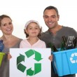 Family recycling bottles — Stock Photo