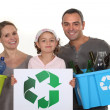 Family recycling bottles — Stock Photo #8115451
