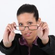 Young woman trying her glasses — Stock Photo