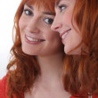 Portrait of smiling redhead woman — Stock Photo #8117370