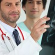 Royalty-Free Stock Photo: Two medics examining an X ray