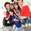 Stock Photo: Group of French football fans celebrating