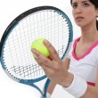 Tennis player about to serve - Stock Photo