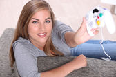 Teenage girl with games controller — Stock Photo