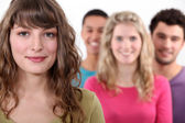 Woman standing in front of her peer group — Stock Photo