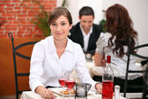 Young woman on a date in a restaurant — Stock Photo