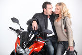 Biker couple gazing into each other's eyes. — Stock Photo
