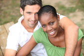Interracial couple in a park — Stock Photo