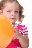 Little girl holding a balloon — Stock Photo