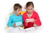 Boy and girl playing video games — Stock Photo