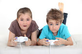 Brother and sister playing video games — Stock Photo
