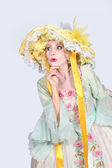Theatrical woman dressed in a large bonnet and flouncy dress — Stock Photo