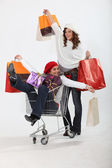 Friends on a retail blowout — Stock Photo