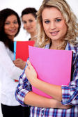Young woman at school with her friends — Stock Photo