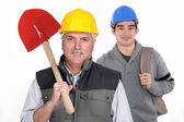Experienced tradesman standing in front of his apprentice — Stock Photo